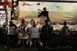 Butlins Bognor Regis: Teenagers play the Gold Rush Derby game at Butlins in Bognor Regis