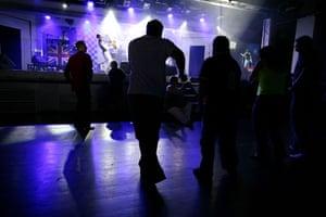 Butlins Bognor Regis: People at the camp dancing at an evening show at Butlins in Bognor Regis