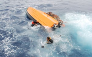 An inflatable capsizes in icy Antarctic waters