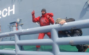 Giles Lane gives the thumbs up after successfully landing on the deck of the Yushin Maru