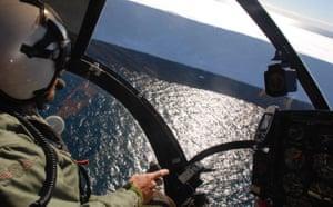 The Sea Shepherd helicopter follows the Yushin Maru