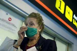 International Swine Flu: A passenger wearing a mask arrives at the Barajas Airport in Madrid