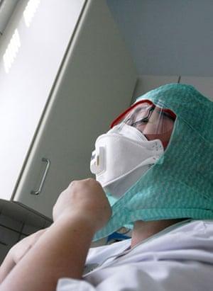 International Swine Flu: A nurse wears protective clothing at Aurora Hospital in Helsinki