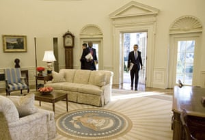 obama 100 days : Barack Obama in the oval office on his first day as president