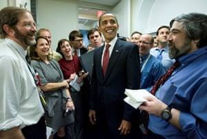 obama 100 days : President Barack Obama, surrounded by White House correspondents