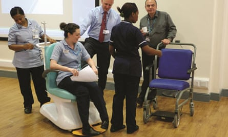 Hospital staff try out redesigned porter's chair