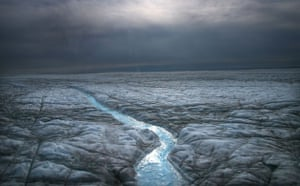 Glaciers under treat: Melted water runs over the Greenlandic Icecap , east to  Ilulissat
