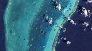 Satellite Eye: the Great Blue Hole and Lighthouse Reef in the Caribbean Sea