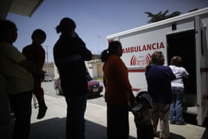 Swine flu La Gloria: People line up to to get medical attention in La Gloria, Mexico.