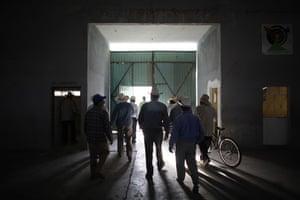 Swine flu La Gloria: Local farmers leave a sports centre after a meeting in La Gloria village.