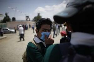 Swine flu La Gloria: A youth wearing a face mask stands in La Gloria