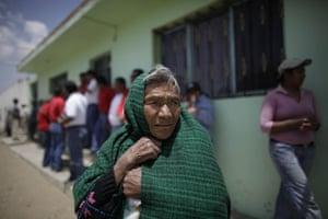 Swine flu La Gloria: A woman stands outside the home of a child who survived the swine flu.