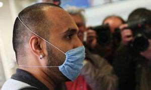 Swine flu mask wearer