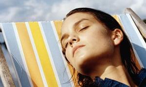 sunbathing woman deckchair