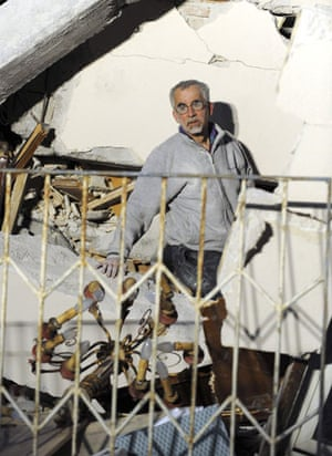 Italy earthquake: A man looks for his relatives amongst debris