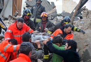 Italy earthquake: Rescue teams retrieve a person from a building