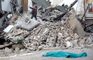 Italy earthquake: The body of a victim lies on the street