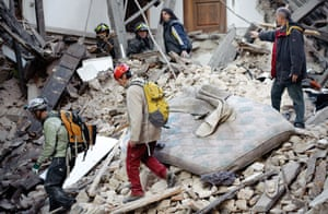 Italy earthquake: Rescuers search for trapped people under the ruins of a collapsed house