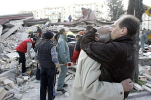 Earthquake in Italy: People stand amidst debris