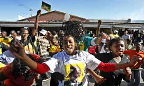 A supporter of the ANC leader celebrates in Guguletu, Cape Town