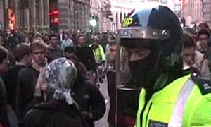 A masked police officer at the G20 protest in London
