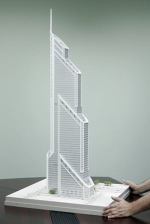 Green skyscrapers: A man places a model of US architect Frank Williams' Mercury City Tower