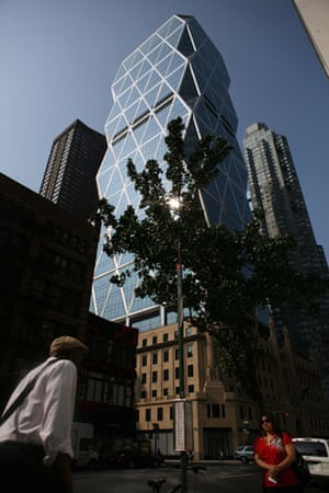 Green skyscrapers: New York residents walk past the Hearst Tower