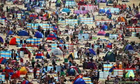 Holidaymakers on the beach in Newquay, Cornwall