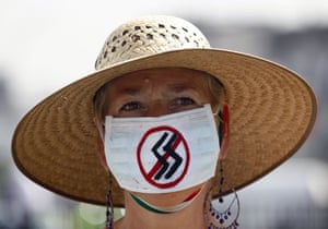 Swine flu face masks: A woman wears a surgical mask in Mexico City