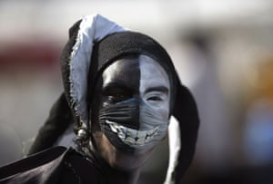 Swine flu face masks: A street performer wears a surgical mask painted with an image of teeth