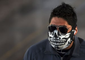 Swine flu face masks: A man wears a painted face mask in Mexico City