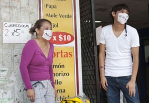 Swine flu face masks: Residents wearing customised surgical masks in Mexico City