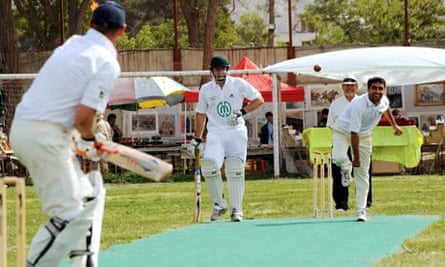 A member of Afghanistan's cricket team bowls during a match between Ditchling and Kabul.