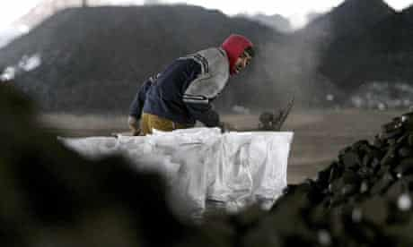 A worker collects coal in Bulgaria
