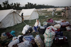 Pakistan Swat exodus: A young internally displaced girl sorts through her family's belongings