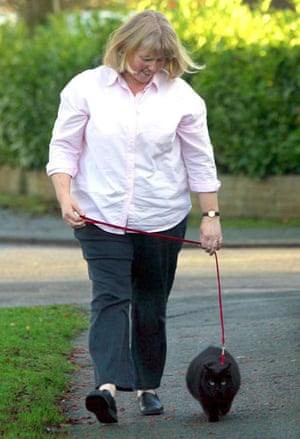 Overweight pets: 2003: Ursula Harris taking Treacle for a walk to lose weight in Cheshire
