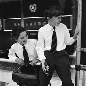 School uniforms: Two schoolchildren in brilliant white shirts outside Selfridges, 1964.