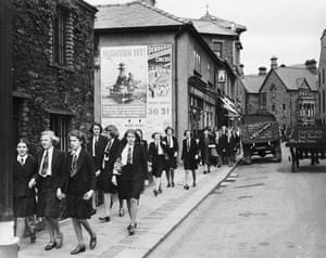 School uniforms: 1940s: Girls From Roedean School walk through the streets of Keswick