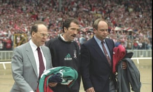 Liverpool manager Graeme Souness is helped onto the pitch at the 1992 FA Cup final