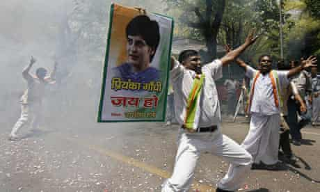 A supporter of India's ruling Congress party after the party's clear victory in the general election