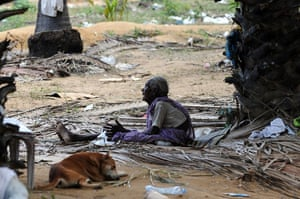 Tamil Tigers surrender: An elderly Sri Lankan Tamil civilian sits among the rubble of a village