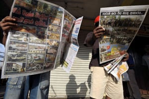 Tamil Tigers surrender: Sri Lankan people read newspapers which report the victory over the LTTE