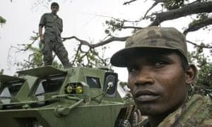 Sri Lankan army soldiers stand guard in Mullaittivu