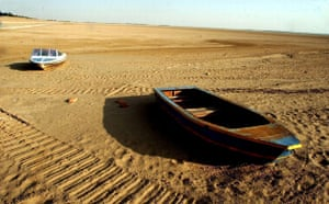 Minqin China: Boats rest on the bottom of a dried reservior oasis in China