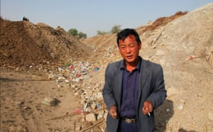 Minqin China: Huang at the bottom of a dried-up river that once ran past his his old home