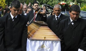 Relatives mourn a Roma man shot dead