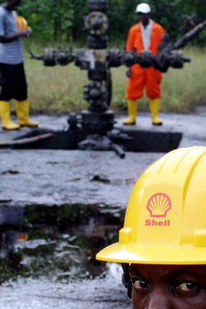 Shell in the Niger Delta: A Nigerian Shell worker watches over a spillage of crude oil near Oloibiri