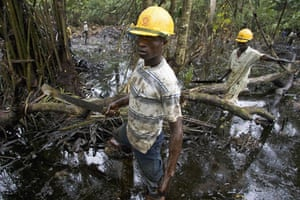 Shell in the Niger Delta: Workers subcontracted by Shell clean up an oil spill in Bayelsa