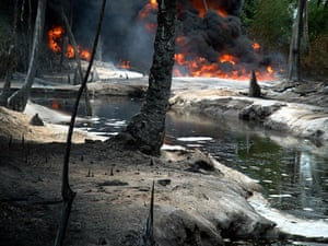Shell in the Niger Delta: Oil from a leaking pipeline burns in Goi-Bodo, a swamp in the Niger Delta