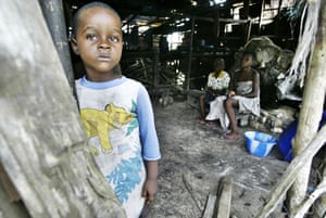 Shell in the Niger Delta: Lili Okrika stands at the entrance to their shack house in Biriya-Ama